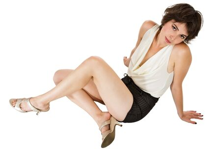Glamorous sexy dark-haired young woman seated on floor leaning back in graceful pose photo