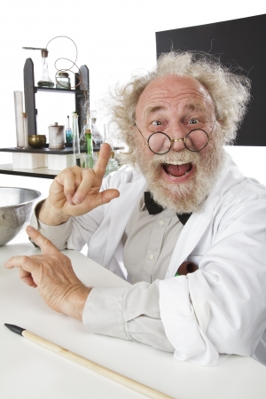 Enthusiastic eccentric senior scientist in his lab, pointing up and excited about his ideas. High key, vertical, copy space. photo