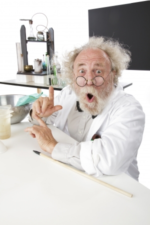 Enthusiastic eccentric senior scientist in his lab, points up excited about ideas. High key, vertical, copy space. Stock Photo - 16962242