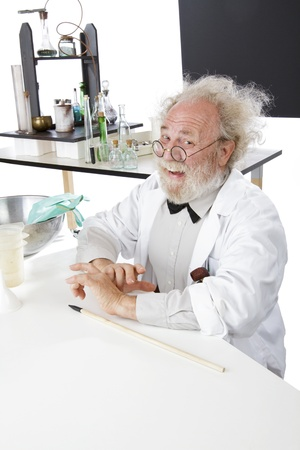 Eccentric smiling senior scientist in his lab with blackboard and pointer. Stock Photo - 16962229