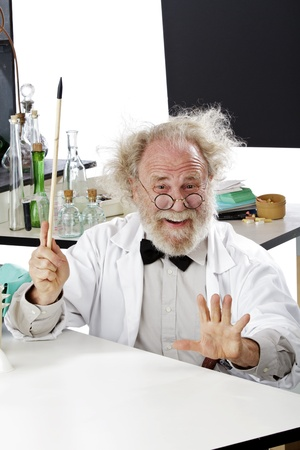 Enthusiastic eccentric senior scientist in his lab points up excited about ideas. High key, vertical, copy space. Stock Photo - 16962214