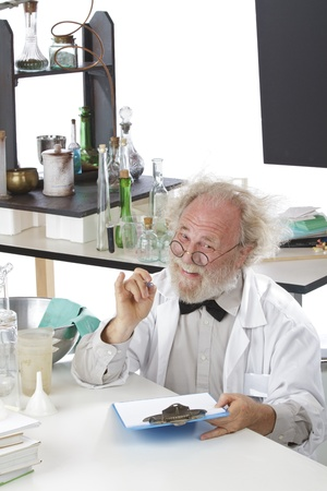 Eccentric senior scientist in lab holds pen and clipboard. High key, white background, vertical, copy space. Stock Photo - 16962211