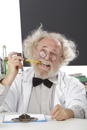 Eccentric senior scientist in lab holds pipe, thinks of ideas. HIgh key, vertical, copy space.