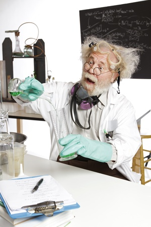 Mad scientist in lab pouring chemicals photo