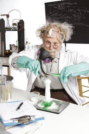 Amazed mad senior scientist in lab reacts to foaming green liquid overflowing beaker  Frizzy grey hair, round glasses, lab coat, aqua rubber gloves, blank blackboard, vertical, high key, copy space