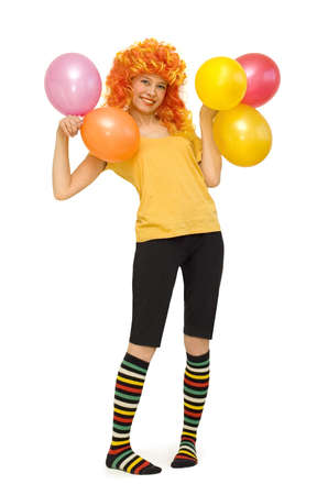 A funny girl in a bright wig with beads photo