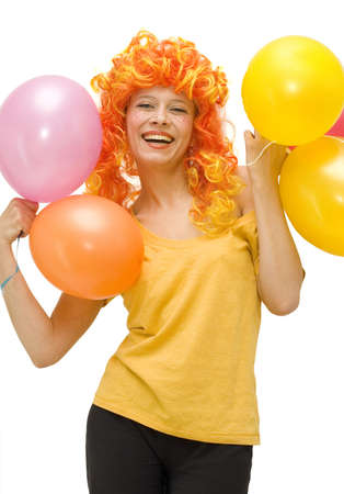 Funny girl in a bright wig laughs photo