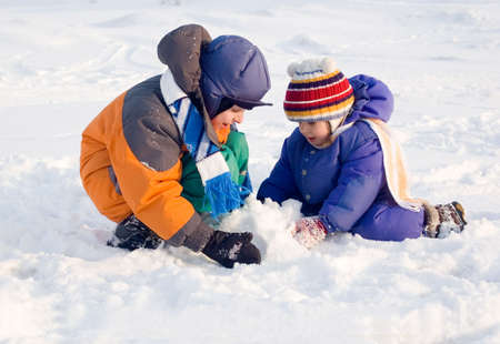 Children playing in the snow Stock Photo - 7612846