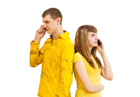 The guy and the girl speak on the phone Stock Photo