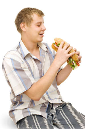 dearth: A young man with a big sandwich, white background