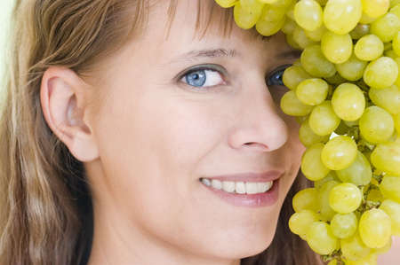 largely: Girls face with grapes largely
