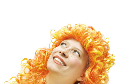 periwig: Girl in a bright wig looks back to top Stock Photo