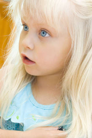Portrait of the surprised little girl with a fair hair Stock Photo - 7940730