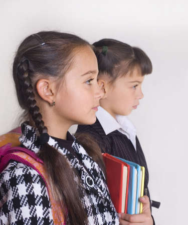 Portrait of two schoolgirls in a profile Stock Photo - 7940747