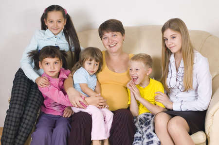 parentage: The pregnant woman with five children of different age Stock Photo