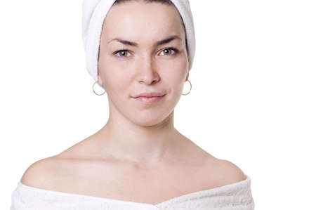 The young woman in a towel, a white background photo