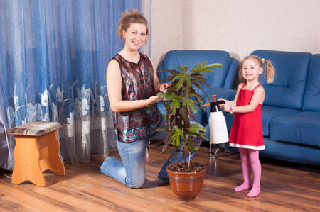 look after: Mum and the daughter look after for a flower Stock Photo
