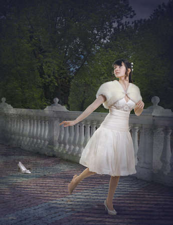 Cinderella flees the ball dropped her slipper Stock Photo