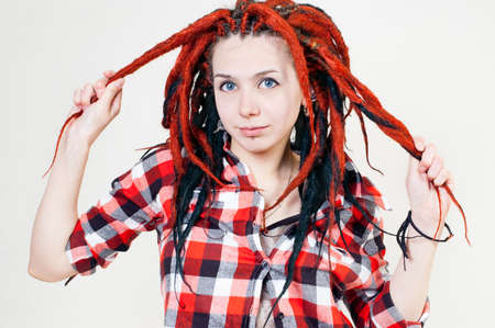 informal clothes: Girl with dreadlocks in his shirt