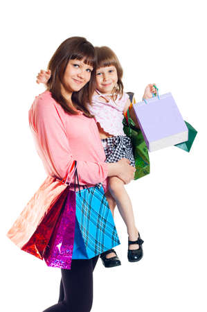 Girl with a child with shopping, white background