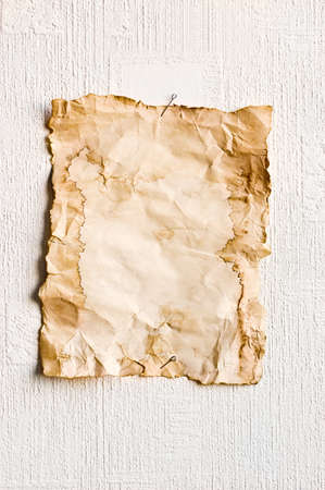 discolored: Sheet of old paper pinned to the wall