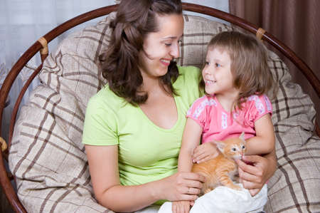 mother and daughter and the kitten,  interior photo