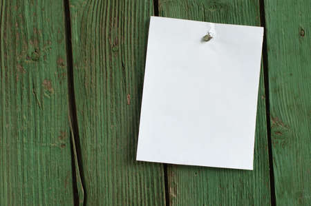 White paper on wooden wall photo