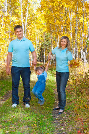 Young family in autumn forest Stock Photo - 10661623