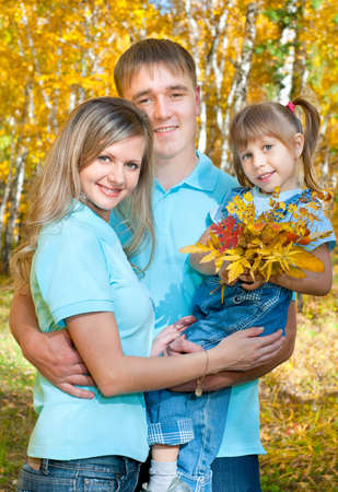 Young family in autumn forest Stock Photo - 10661624