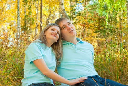Young couple in the autumn forest photo