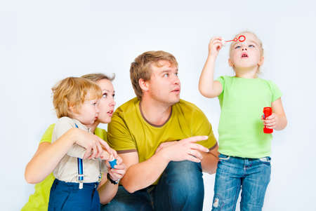 to inflate: family with childrens inflate bubbles Stock Photo
