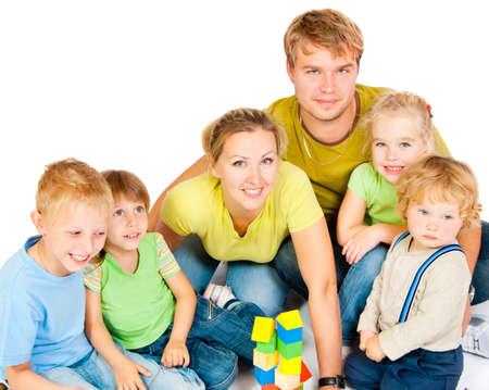 big five: Grande famiglia con quattro bambini su uno sfondo bianco Archivio Fotografico