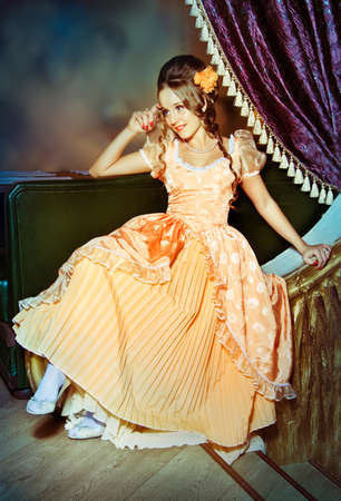 waltzing: A girl in a ball gown sits