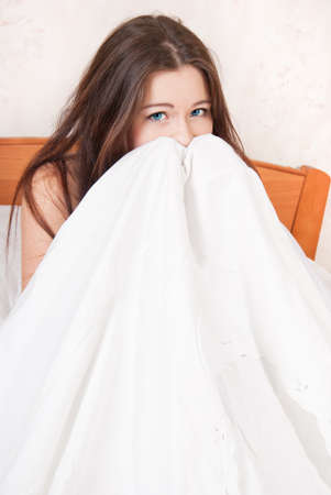 Afraid girl hiding under a blanket Stock Photo - 11312483