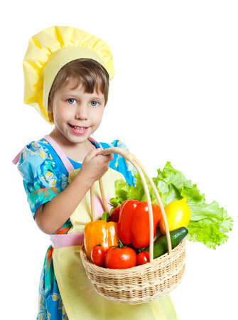 Girl holding a basket of vegetables, on white background photo