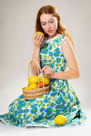 Red-haired girl with the apples photo