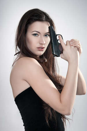 Girl aiming a gun, arms outstretched Stock Photo - 12029061