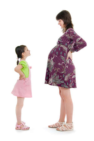 Pregnant mum costs opposite to the daughter, a white background