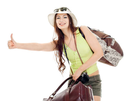 The girl shows catches a passing car, white background