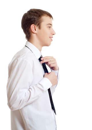 corrects: The teenager corrects a tie, appointment Stock Photo