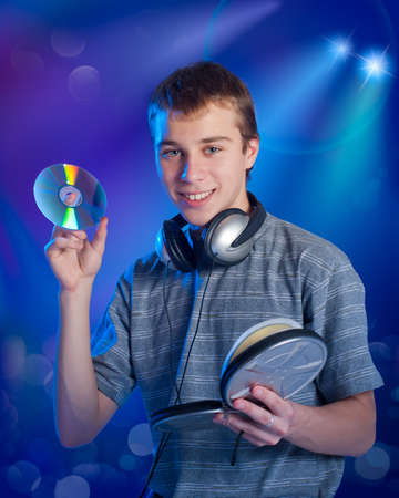 The teenager chooses music on a disk Stock Photo - 12296702