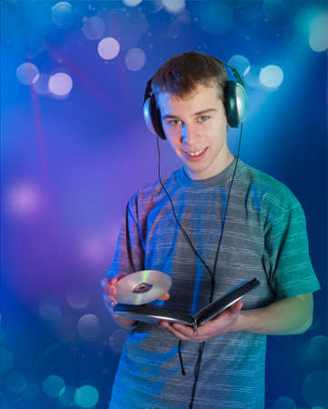 The teenager chooses music on a disk Stock Photo - 12296784