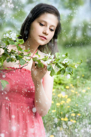 Beautiful girl with flowering branches photo