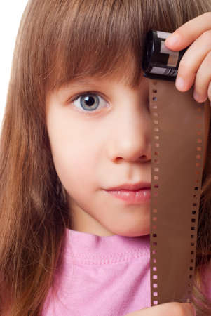 Little girl with a film from the camera Stock Photo - 12603374