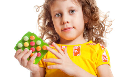 The girl keeps vitamins in packages Stock Photo - 12603436