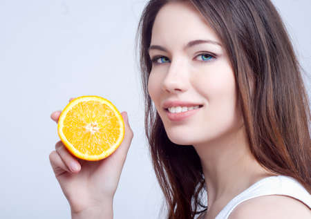 Portrait of a beautiful young girl with an orange Stock Photo - 12888375