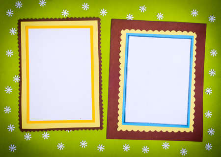 Frame made  of paper on a green background photo