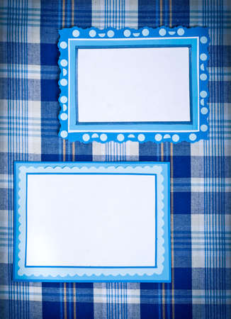 frames of colored paper on a checkered cloth photo