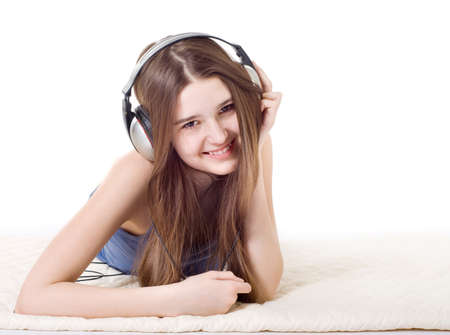 mouth closed: The girl is a teenager in the headphones and listening to music