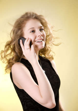 Girl talking on the phone, a yellow background photo
